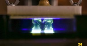 Image of 3D printing with light with logo of Michigan University on it